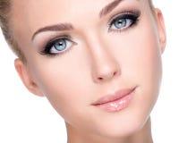 Portrait of beautiful white woman with long false eyelashes Stock Photos
