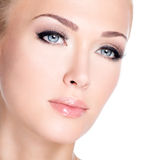 Portrait of beautiful white woman with long false eyelashes Royalty Free Stock Images