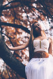 Portrait of beautiful wiccan girl in the forest Royalty Free Stock Photography