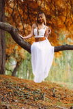 Portrait of beautiful wiccan girl in the forest Royalty Free Stock Images