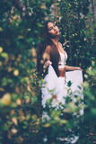 Portrait of beautiful wiccan girl in the forest Royalty Free Stock Image