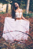 Portrait of beautiful wiccan girl in the forest Royalty Free Stock Photos