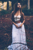 Portrait of beautiful wiccan girl in the forest Stock Image
