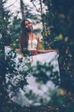 Portrait of beautiful wiccan girl in the forest Stock Images