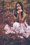 Portrait of beautiful wiccan girl in the forest Stock Photos