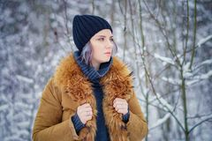 Portrait of a beautiful winter girl. In a forest the snow Royalty Free Stock Photos