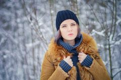 Portrait of a beautiful winter girl. In a forest Royalty Free Stock Photo
