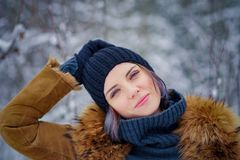 Portrait of a beautiful winter girl. In a forest the snow Stock Photography