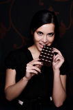 Portrait of beautiful woman. With a chocolate Stock Photography