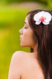Portrait of beautiful woman. Portrait of appealing young beautiful naked woman with flower in her hair Stock Photo