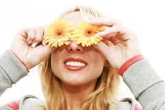 Portrait of beautiful woman. Portrait of beautiful smiling blond woman with yellow flowers Royalty Free Stock Image