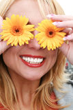 Portrait of beautiful woman. Portrait of beautiful smiling blond woman with yellow flowers Royalty Free Stock Photo