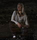 Portrait of  beautiful woman in an abandoned factory in reflection Royalty Free Stock Images