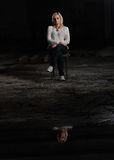 Portrait of  beautiful woman in an abandoned factory with reflection Stock Photo
