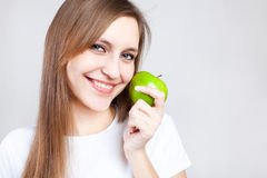 Portrait of beautiful woman with apple Stock Photo