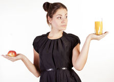 Portrait of beautiful woman with apple and juice Royalty Free Stock Photos