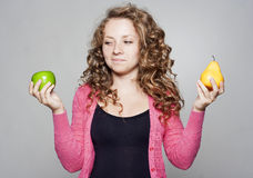 Portrait of beautiful woman with an apple and pear Royalty Free Stock Photo