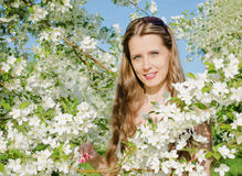 Portrait of beautiful  woman with apple tree flowers Royalty Free Stock Photography