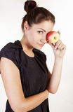 Portrait of beautiful woman with apple royalty free stock image