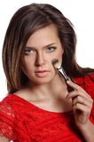 Portrait of beautiful woman applying cosmetic. Make-up Royalty Free Stock Photos