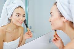 Portrait of beautiful woman applying eyeshadow Stock Photo