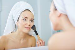 Portrait of beautiful woman applying eyeshadow Stock Image