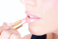 Portrait of beautiful woman applying lipstick Royalty Free Stock Images