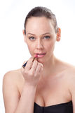 Portrait of beautiful woman applying lipstick Stock Photography