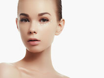 Portrait of beautiful woman applying some cream to her face for skin care Royalty Free Stock Photos