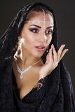 Portrait of a beautiful woman with arabian makeup in black paran Royalty Free Stock Photography
