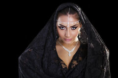 Portrait of a beautiful woman with arabian makeup in black paran Royalty Free Stock Image