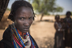 Portrait of a beautiful woman from Arbore tribe, Omo valley. TURMI, ETHIOPIA, 16 AGOSTO 2015: unidentified Arbore women wearing colored necklaces. Different Stock Photo