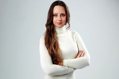 Portrait of a beautiful woman with arms folded Stock Photography