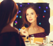 Portrait of a beautiful woman as applying makeup Royalty Free Stock Photography