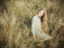 Portrait of beautiful woman on autumn field Stock Photography