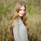 Portrait of beautiful woman on autumn field Royalty Free Stock Photography
