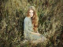 Portrait of beautiful woman on autumn field Royalty Free Stock Photos