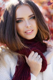 Portrait of beautiful woman in autumn Park royalty free stock image