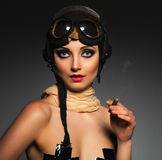 Portrait of a beautiful woman aviator with a glamorous retro mak Stock Photos