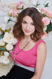 Portrait of a beautiful woman on the background flowers roses Royalty Free Stock Photos