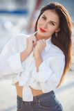 Portrait of a beautiful woman on the background of the sea and yachts Stock Photography