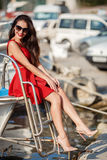 Portrait of a beautiful woman on the background of the sea and yachts royalty free stock image