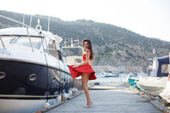 Portrait of a beautiful woman on the background of the sea and yachts Royalty Free Stock Images