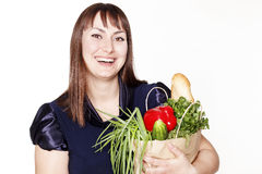 Portrait of beautiful woman with a bag of products Royalty Free Stock Photography