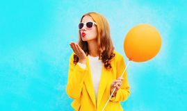 portrait of beautiful woman with balloons sends an air kiss Stock Photos