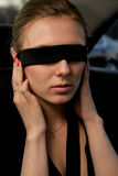 Portrait of a beautiful woman with bandage on eyes Royalty Free Stock Image
