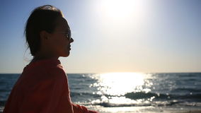 Portrait of beautiful woman on the beach closeup . view girl with sunglasses smiling stock video footage