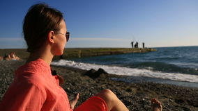 Portrait of beautiful woman on the beach closeup . view girl with sunglasses smiling stock footage