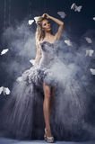 Portrait of beautiful woman. Beauty blonde woman on the fog with butterflies Royalty Free Stock Photography