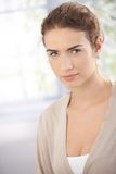 Portrait of beautiful woman in beige Royalty Free Stock Image